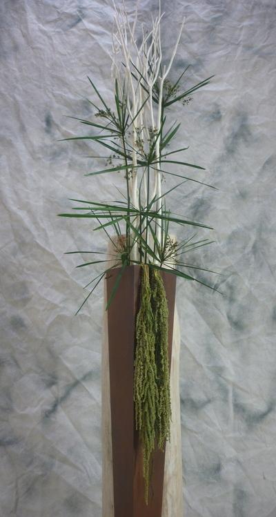 Vase en acier et en bois flotté